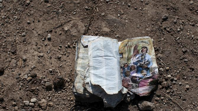A ruined book is seen at an area affected by a mudslide in Santa Catarina Pinula, on the outskirts of Guatemala City
