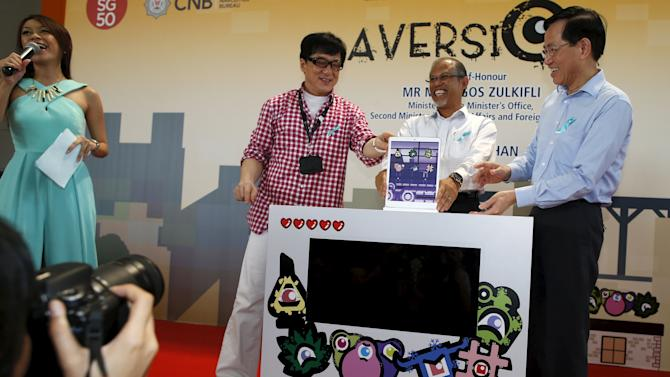 Singapore's new anti-drug ambassador Jackie Chan launches an anti-drug mobile game application at Nanyang Polytechnic in Singapore