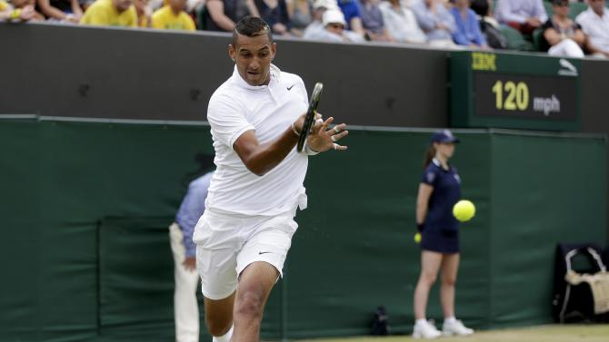 Nick Kyrgios of Australia hits a shot during his match against Richard Gasquet of France at the Wimbledon Tennis Championships in London