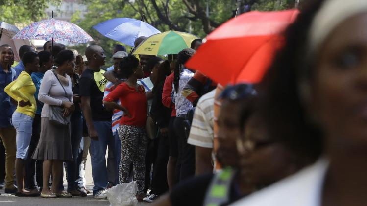 People queue to view the body of former South African President Nelson Mandela outside the Union Buildings