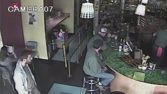 This frame grab provided by the Seattle Police Department shows a man believed to be the suspect in a shooting, left, at Cafe Racer on Wednesday, May 30, 2012 in the University district of Seattle. The gunman killed four people — three at the cafe and another in a carjacking — before he apparently shot himself as officers closed in following a citywide manhunt, authorities said. (AP Photo/Seattle Police Department)