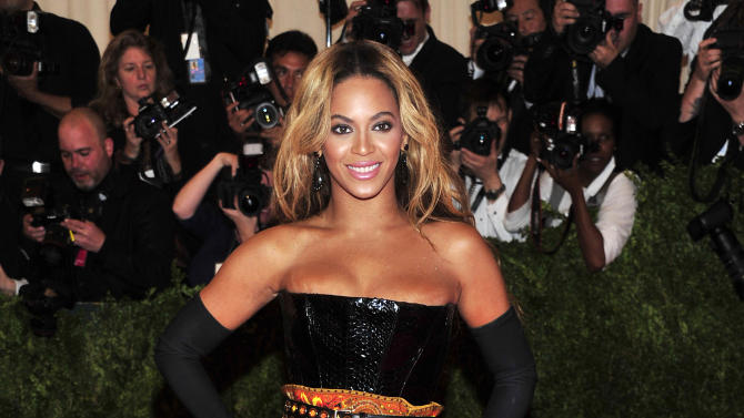 FILE - This May 6, 2013 file photo shows singer Beyonce at The Metropolitan Museum of Art's Costume Institute benefit in New York. Beyonce is canceling her Tuesday, May 14, concert in Belgium because of dehydration and exhaustion. In an email to The Associated Press, the singer's publicist says Beyonce has been advised by her doctors to rest. She was scheduled to perform at the Sportpaleis in Antwerp. The show will be rescheduled and tickets can be used at that show. (Photo by Charles Sykes/Invision/AP, file)
