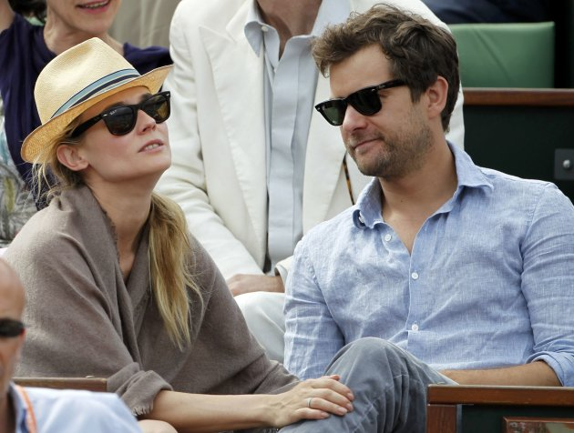 Actors Diane Kruger and Joshua Jackson attend a match during the French Open tennis tournament at the Roland Garros stadium in Paris
