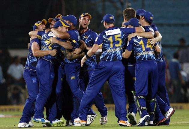 Otago Volts players celebrate after fall of a wicket during the Champions League T20 match between Lions and Otago Volts at Sawai Mansingh Stadium, Jaipur on Sept. 29, 2013. (Photo: IANS)