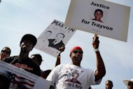 "Trayvon Martin supporters gather for a rally in his honor on April 1, in Miami, Florida. UN rights chief Navi Pillay on Thursday called for an ""immediate investigation"" into the circumstances surrounding the February death of the unarmed black US teen, shot by a neighborhood watchman"