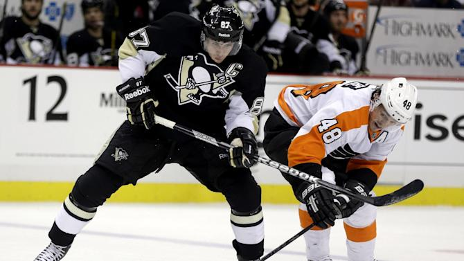 Pittsburgh Penguins center Sidney Crosby (87) battles for control of the puck with Philadelphia Flyers center Danny Briere (48) in the second period of an NHL hockey game in Pittsburgh, Wednesday, Feb. 20, 2013. (AP Photo/Gene J. Puskar)
