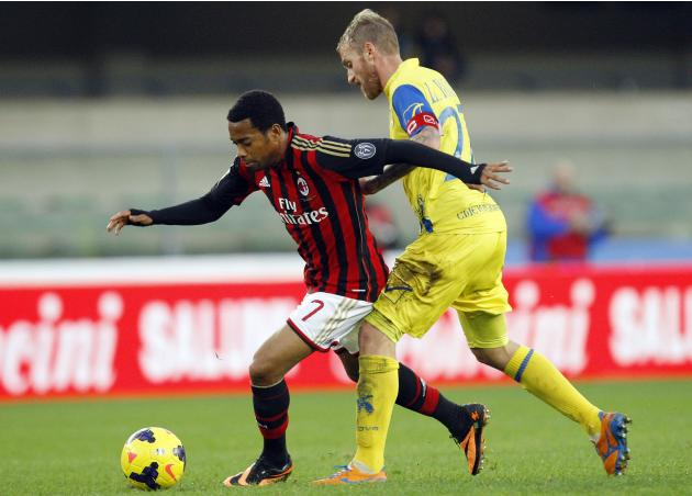 AC Milan's Robinho fights for the ball with Chievo Verona's Rigoni during their Italian Serie A soccer match in Verona