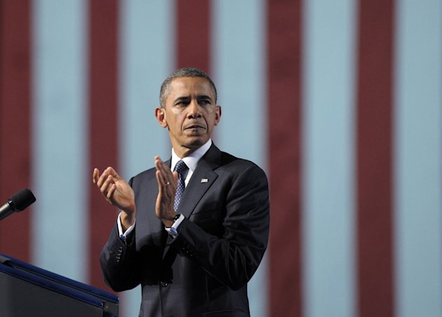 President Barack Obama looks back to applaud those that served during his remarks at the 113th National Convention of the VFW in Reno, Nev., Monday, July 23, 2012. (AP Photo/Susan Walsh)