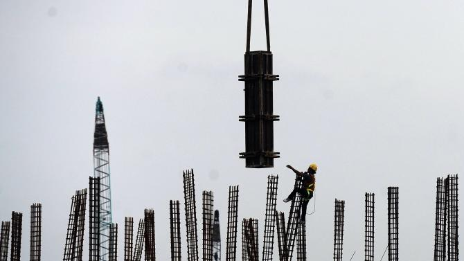 An Indonesian construction worker is seen working on part of the the New Priok port project, an extension of the existing Tanjung Priok port, in North Jakarta