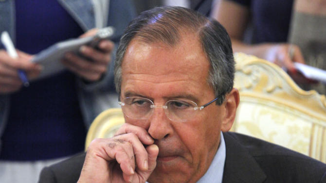 """Russian Foreign Minister Sergey Lavrov, listens to Tunisian Foreign Minister Rafik Abdessalam, unseen, during their talks in Moscow, Russia, Thursday, June 28, 2012. Russia is denying comments by a U.S. official that it has endorsed a Syrian transition plan that includes a call for President Bashar Assad to give up power in favor of a national unity government saying that outside forces must concentrate on convincing opposition groups to soften their demands. But, Russian Foreign Minister Sergey Lavrov denied that Thursday. """"We are not supporting and will not support any external meddling,"""" he said. (AP Photo/Alexander Zemlianichenko)"""