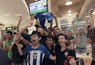 Hondurans cheer their team as they watch on television the Honduras vs Brazil London 2012 Olympic Games football match in Tegucigalpa, on August 4, 2012. AFP PHOTO/STR