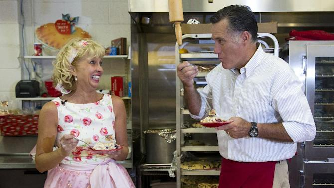 Linda Hundt, owner of Sweetie-licious Bakery, left, laughs as Republican presidential candidate, former Massachusetts Gov. Mitt Romney takes a bite of cherry pie during a campaign stop at Sweetie-licious Bakery on Tuesday, June 19, 2012 in DeWitt, Mich.  (AP Photo/Evan Vucci)