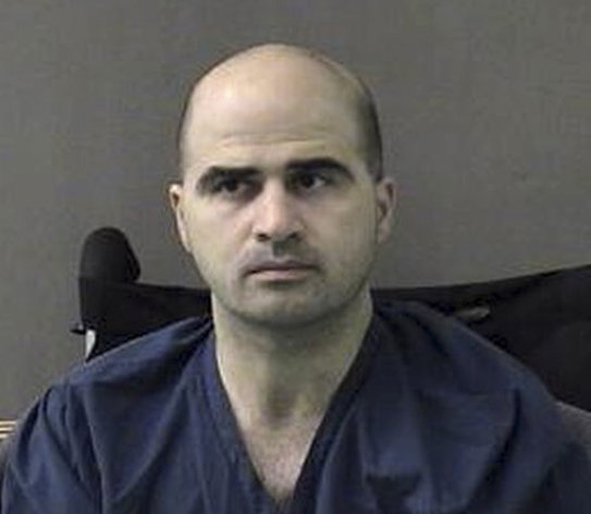 FILE - An April 9, 2010 file photo provided by the Bell County Sheriffs Department, shows U.S. Maj. Nidal Hasan at the San Antonio to Bell County Jail in Belton, Texas. Judge, Col. Gregory Gross, is to decide at a pretrial hearing Tuesday Aug. 14, 2012, whether to delay the trial of Hasan. (AP Photo/Bell County Sheriffs Department, File)