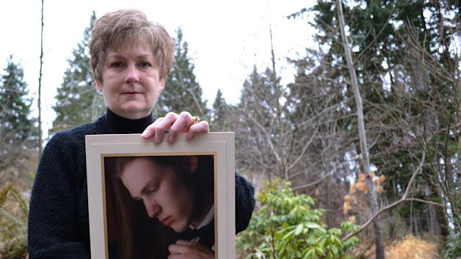 In this Feb. 16, 2013 photo, Karen Williams poses with a photo of her deceased son, Loren, in Beaverton, Ore. Williams, who battled Facebook over the right to view Loren's Facebook page, has been urging lawmakers for years to do something to prevent others from losing photos, messages and other memories that otherwise could be accessed at the click of a mouse. This year the Oregon Legislature took up the cause, only to be turned back by pressure from the tech industry, which says they must abide by a 1986 federal law that prevents them from sharing such information. (AP Photo/Lauren Gambino)