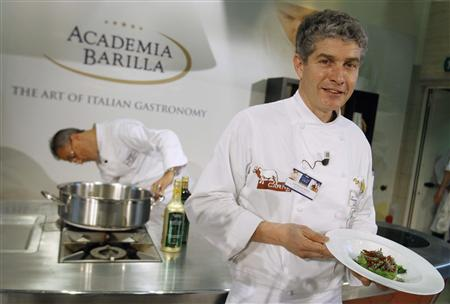 Chef Giorgio Nava of Italy poses for a photo with his pasta during the Pasta World Championship final in Parma June 15, 2013. REUTERS/Alessandro Garofalo