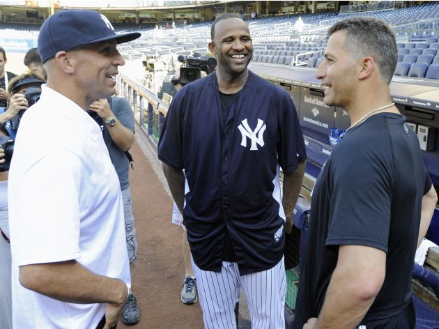 Brooklyn Nets coach Jason Kidd talks with New York Yankees' pitchers CC Sabathia and Andy Pettitte in New York