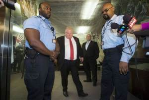 Toronto Mayor Rob Ford walks to respond to the Toronto police investigation in Toronto