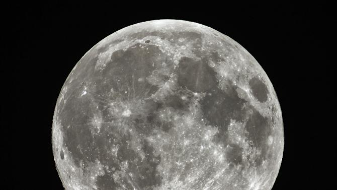 """A closer, brighter full moon dubbed a """"supermoon"""" is shown around 12:30 a.m. Sunday, June 23, 2013 in this picture made through an amateur astronomer's 5-inch refractor telescope, near Stedman, N.C. (AP Photo/The Fayetteville Observer, Johnny Horne)"""