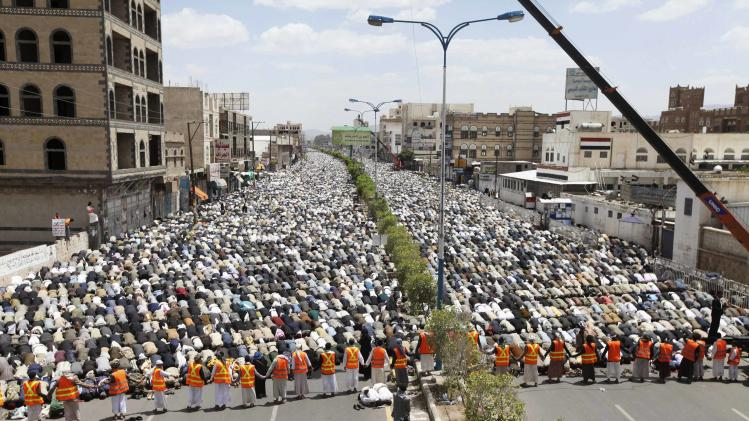 Followers of Shi'ite Houthi group pray during rally to denounce fuel price hikes and to demand for the resignation of the government in Sanaa