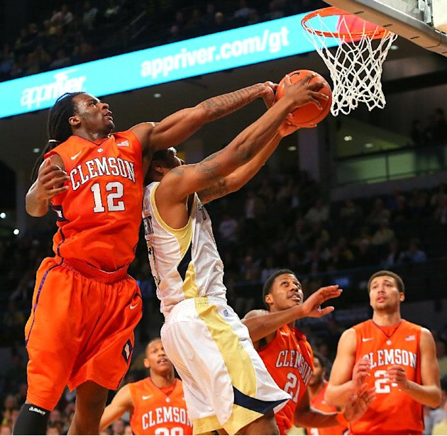 Clemson guard Rod Hall (12) blocks a shot by Georgia Tech guard Marcus Georges-Hunt during the first half of their NCAA college basketball game, Thursday, Feb. 14, 2013, in Atlanta. (AP Photo/Atlanta 