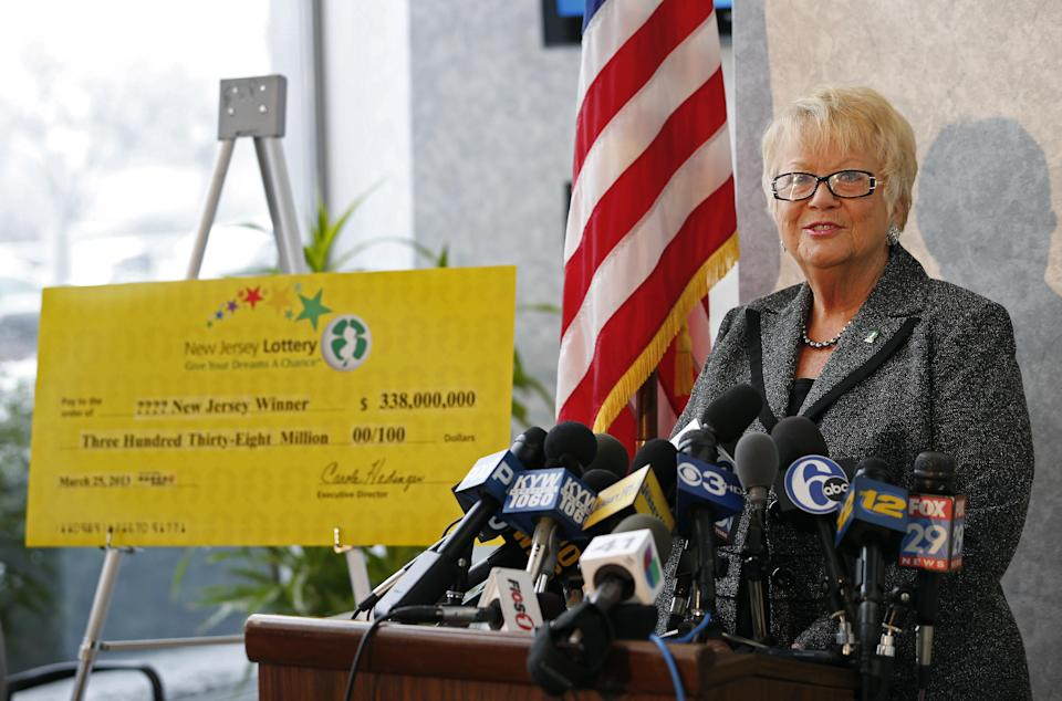Carole Hedinger, Executive Director of the New Jersey Lottery, announces that the winning ticket in the $338 million Powerball was sold at Eagle Liquors in Passaic  N.J.. The announcement was made from lottery headquarters in Lawrence, N.J. Monday, March 25, 2013. (AP Photo/Rich Schultz)