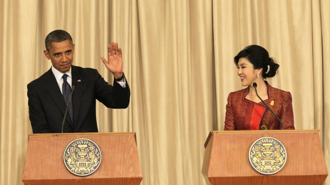 U.S. President Barack Obama, left, and Thai Prime Minister Yingluck Shinawatra hold a joint press conference at the Government House in Bangkok, Thailand, Sunday, Nov. 18, 2012. (AP Photo/Sakchai Lalit)