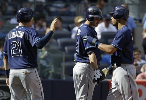Martin, Yankees hold off Rays, keep AL East edge