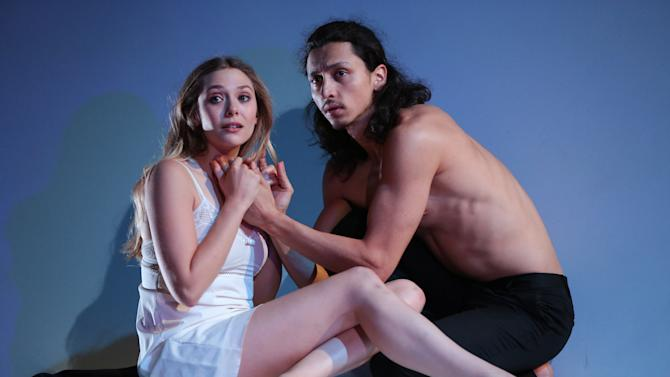 """This photo released by The Publicity Office shows, from left, Elizabeth Olsen and Julian Cihi in a scene from Shakespeare's """"Romeo & Juliet,"""" currently performing off-Broadway at Classic Stage Company in New York. (AP Photo/The Publicity Office, Joan Marcus)"""