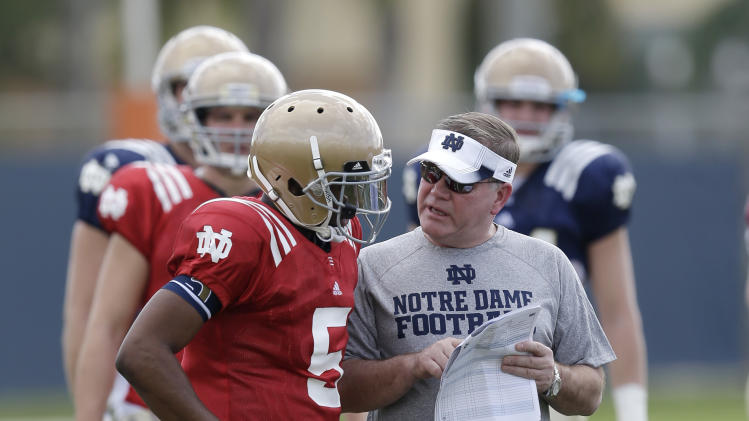 Notre Dame head coach Brian Kelly, right, talks with quarterback Everett Golson during practice, Thursday, Jan. 3, 2013, at the Miami Dolphins' training facility in Davie, Fla. Notre Dame is scheduled to play Alabama on Monday, Jan. 7, in the BCS national championship NCAA college football game. (AP Photo/Wilfredo Lee)