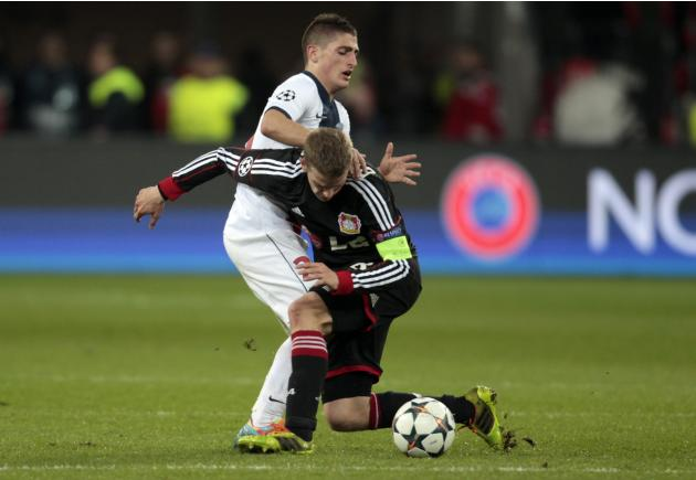 Bayer Leverkusen's Bender tackles Paris St. Germain's Verratti during their Champions League soccer match in Leverkusen