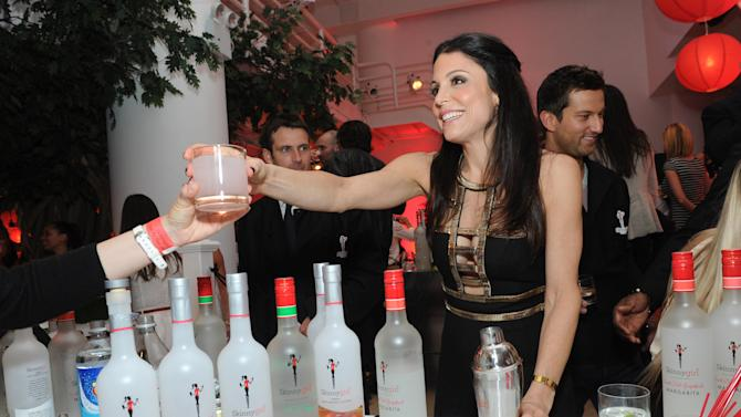 """IMAGE DISTRIBUTED FOR SKINNYGIRL COCKTAILS - The original Skinnygirl Bethenny Frankel helps introduce fans to the new girls, Skinnygirl Mojito, Skinnygirl Sweet 'n Tart Grapefruit Margarita, Skinnygirl White Cherry Vodka and Skinnygirl Moscato, at the Skinnygirl Cocktails """"Meet the New Girls"""" launch party, Thursday, April 18, 2013 in New York.  Frankel and her guest mixologists tended bar, pouring the four new innovations from Skinnygirl Cocktails and donating all of their tips to Dress for Success. (Diane Bondareff/Invision for Skinnygirl Cocktails/AP Images)"""
