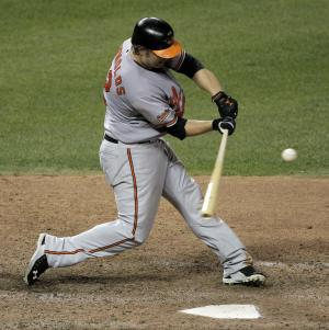 Baltimore Orioles' Mark Reynolds hits a three-run home run during the ninth inning of a baseball game against the Kansas City Royals Tuesday, Aug. 2, 2011, in Kansas City, Mo. The Orioles won the game 8-2. (AP Photo/Charlie Riedel)