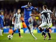 Chelsea's Nigerian midfielder John Mikel Obi (C) fights for the ball with Juventus' Giorgio Chiellini during their UEFA Champions League match in London. Mikel was forced to close his Twitter account after suffering a barrage of racist abuse prompted by his costly mistake against Juventus