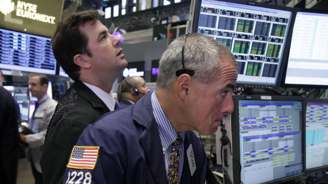 """FILE- In a Wednesday, Aug. 15, 2012, file photo, Trader Frank Cannarozzo, right, works on the floor of the New York Stock Exchange.   Trading volume, the number of shares bought and sold each day, is down by a fifth from last year, more evidence that relatively few investors are pushing up stocks as Main Street folks abandon the market. """"August is usually slow, but this is terrible,"""" says Howard Silverblatt, senior index analyst at S&P Dow Jones Indices.  (AP Photo/Richard Drew, File)"""