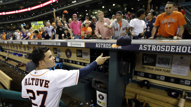 Houston Astros' Jose Altuve signs autographs after a baseball game against the Cleveland Indians Tuesday, Sept. 16, 2014, in Houston. The Indians won 4-2. Altuve set a new franchise single-season hit record after hitting his 211th hit of the season Tuesday. (AP Photo/David J. Phillip)