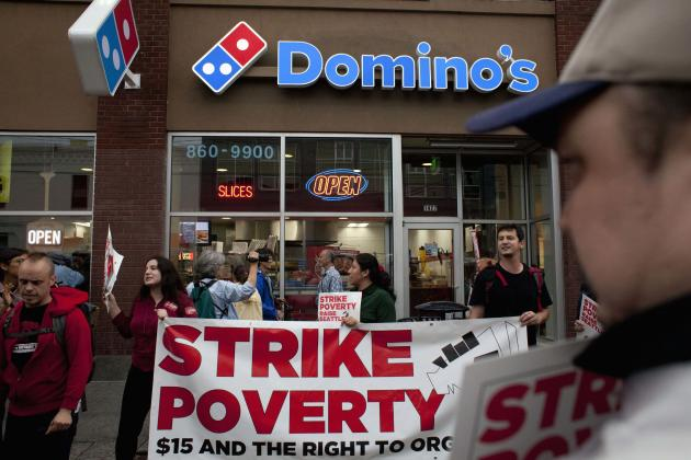 Demonstrators are pictured in front of Domino's Pizza during a strike aimed at the fast-food industry and the minimum wage in Seattle, Washington