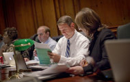 Georgia Professional Standards Commission members Meredith Hodges, right, and Bill Haskin, look over a document before a vote to yank the teaching licenses for for eight teachers and three school administrators accused in the Atlanta schools cheating scandal, Thursday, Oct. 13, 2011 in Atlanta. The commission voted Thursday on the first batch of cases from a state probe that revealed widespread cheating in nearly half of the district's 100 schools as far back as 2001. (AP Photo/David Goldman)