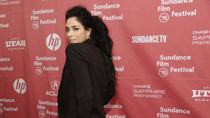 "Sarah Silverman, a cast member in ""I Smile Back,"" turns back for photographers at the premiere of the film at the Library Center Theatre during the 2015 Sundance Film Festival on Sunday, Jan. 25, 2015, in Park City, Utah. (Photo by Chris Pizzello/Invision/AP)"