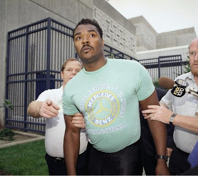 FILE - This July 16, 1992 file photo shows Rodney King being escorted from jail in Santa Ana, Calif. after he was arrested for investigation of drunken driving. King, whose videotaped beating by polic
