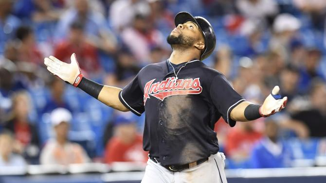 Cleveland Indians' Carlos Santana celebrates his home run against the Toronto Blue Jays during the 19th inning of a baseball game in Toronto on Friday, July 1, 2016.  The Indians won 2-1 in 19 innings. (Frank Gunn/The Canadian Press via AP)