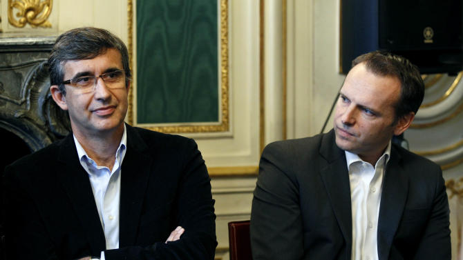Christophe Muller, right, head of YouTube Europe, and Jean-Marc Tassetto, general director of Google France react during a press conference in Paris, Thursday Nov. 25, 2010. YouTube and top associations of French authors say they have struck an agreement to put more TV shows and movies online in France. The deal with three major groups that represent creative talent in France paves the way for authors to get paid when their productions are put on Google's YouTube. (AP Photo/Christophe Ena)