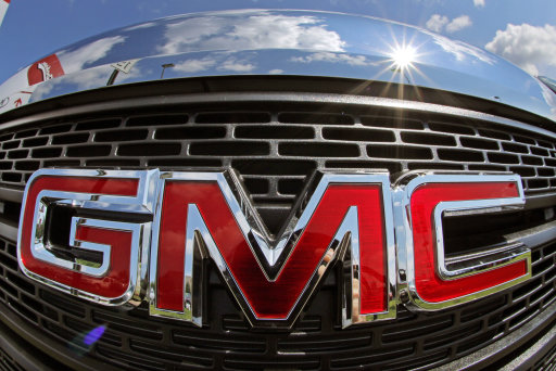 This Tuesday, July 23, 2013, photo, shows a grill of a 2013 GMC Terrain AWD SLT-1 in Pittsburgh. General Motors reports quarterly earnings on Thursday, July 25, 2013. (AP Photo/Gene J. Puskar)