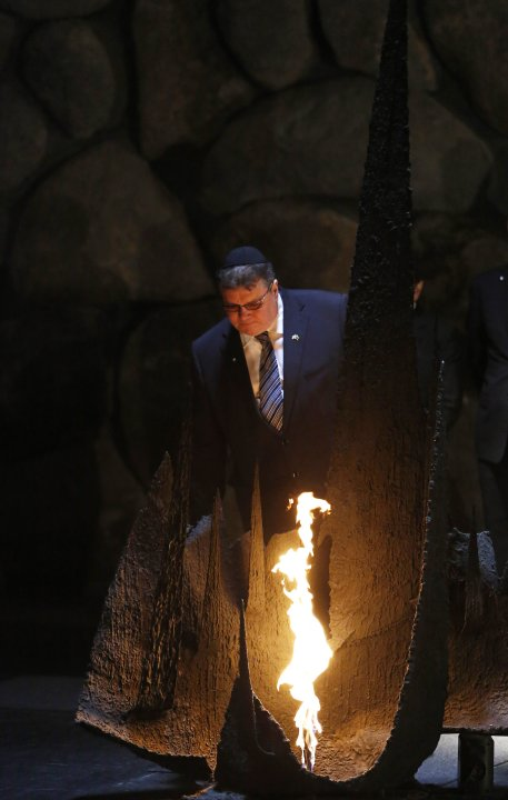 Lithuanian Foreign Minister Linkevicius rekindles the eternal flame during a ceremony at the Yad Vashem in Jerusalem