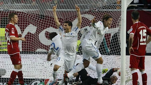 David Abraham celebrates scoring for Hoffenheim in their play-off win at Kaiserslautern (REUTERS).