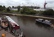 A boat passes along the River Lee near the London 2012 Olympic Stadium in Stratford, east London, on June 26, 2012. The organisers of the London Olympics hope their mammoth �9.3 billion investment will regenerate east London, but critics fear it will only create an island of prosperity amid run-down neighbourhoods