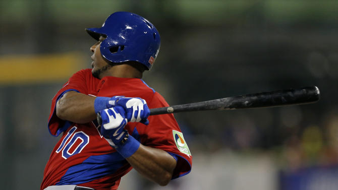Dominican Republic's Edwin Encarnacion hits an RBI single off Puerto Rico's starting pitcher Orlando Roman in the first inning of their World Baseball Classic first round game in San Juan, Puerto Rico, Sunday, March 10, 2013. (AP Photo/Andres Leighton)