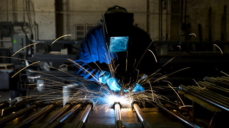 Welder Al Macchione works at custom manufacturer Fox Company Inc., Wednesday, July 16, 2014, in Philadelphia. (AP Photo/Matt Rourke)