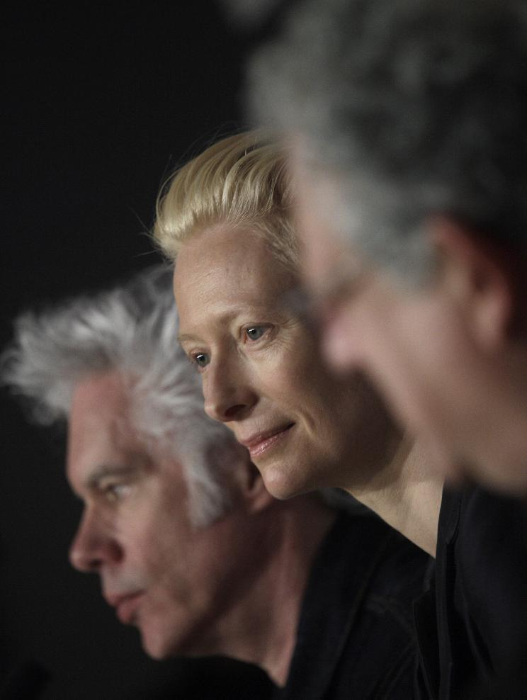 From left, director Jim Jarmusch, actress Tilda Swinton and actor John Hurt participate in a press conference for the film Only Lovers Left Alive at the 66th international film festival, in Cannes, southern France, Saturday, May 25, 2013. (AP Photo/Virginia Mayo)