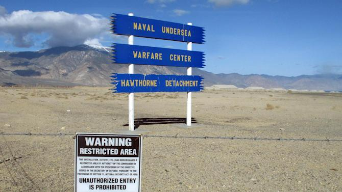 Signs are seen at the Hawthorne Army Depot on Tuesday, March 19, 2013, where seven Marines were killed and several others seriously injured in a training accident Monday night, about 150 miles southeast of Reno in Nevada's high desert. (AP Photo/Scott Sonner)