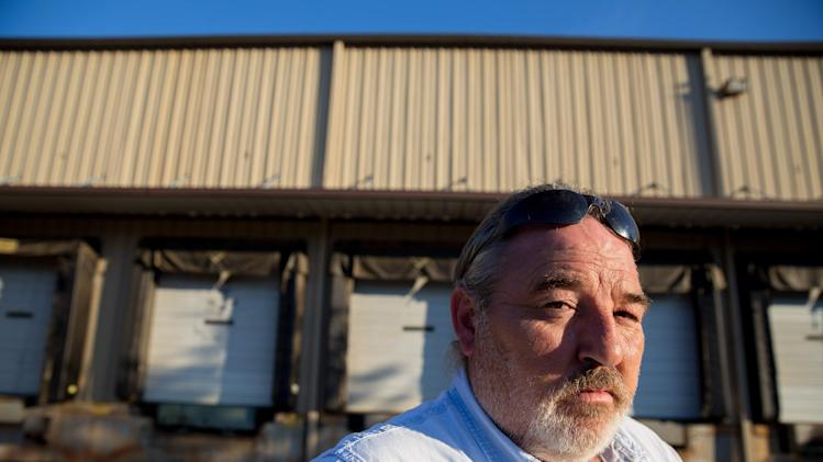 Richard Smith stands in front of a factory that he worked at for 20 years before it was closed in 2010 by the BWAY Corporation in Toccoa